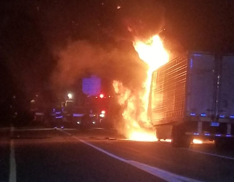 A tractor-trailer hauling frozen food burst into flames on the Maine Turnpike in West Gardiner Monday night.