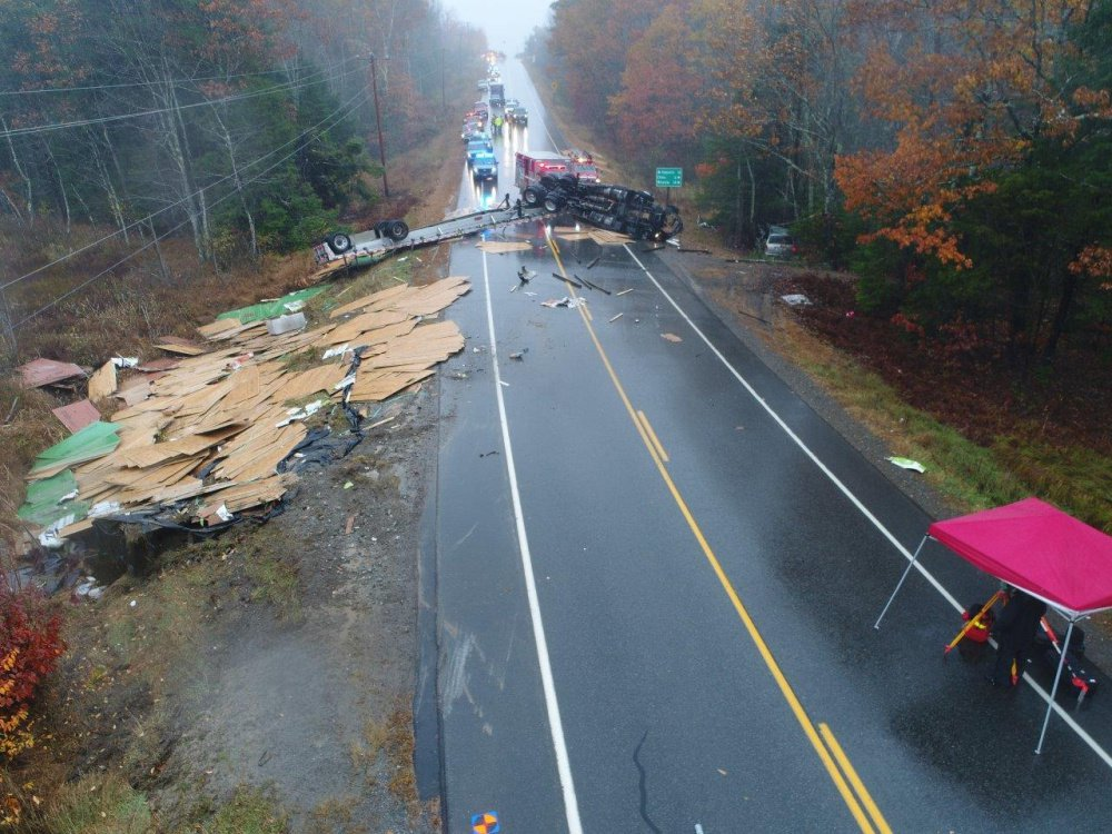 Photo courtesy of Maine State Police   Police and firefighters at the scene of a tractor trailer accident after the rig overturned and dumped building material on Route 3 near the Dirigo Road in China on Wednesday.