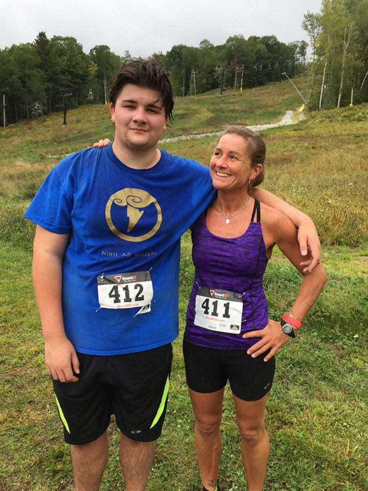 This photo posted in September 2016 to Alice Balcer's Facebook page shows Andrew Balcer, 17, and his mother, Alice, following a running competition. Andrew has been charged with two counts of murder in connection with the deaths of Alice and Antonio Balcer, his parents.