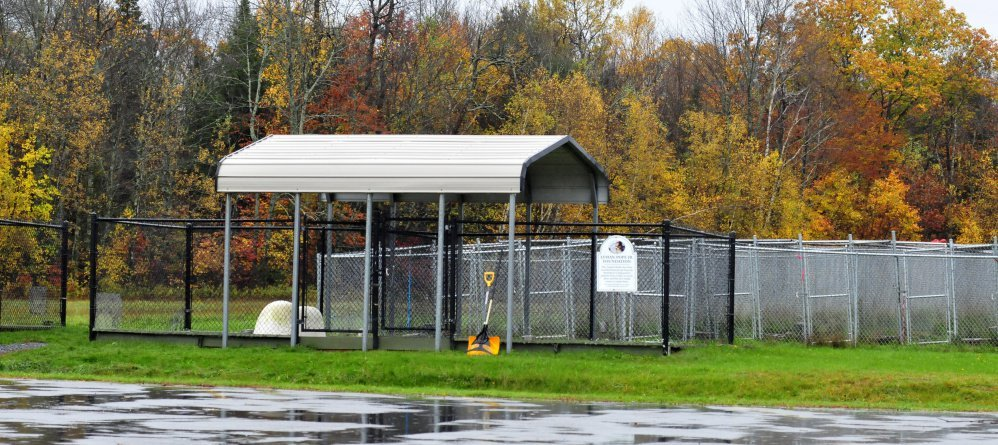An area behind the Humane Society Waterville Area is where dogs frequently are walked and penned outdoors by owners and volunteers. Danielle Jones of Winslow, owner of two pit bull dogs that have been ordered to be euthanized, said the dogs escaped Tuesday while she was walking them.