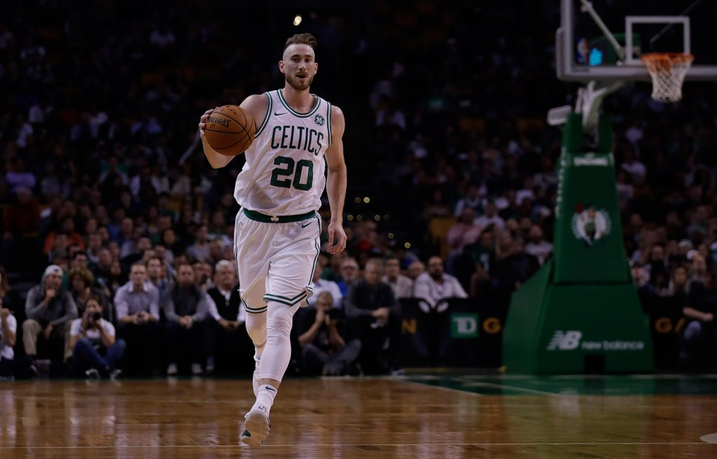 Boston Celtics forward Gordon Hayward brings the ball up court during the first quarter of an NBA preseason basketball game in Boston Monday.
