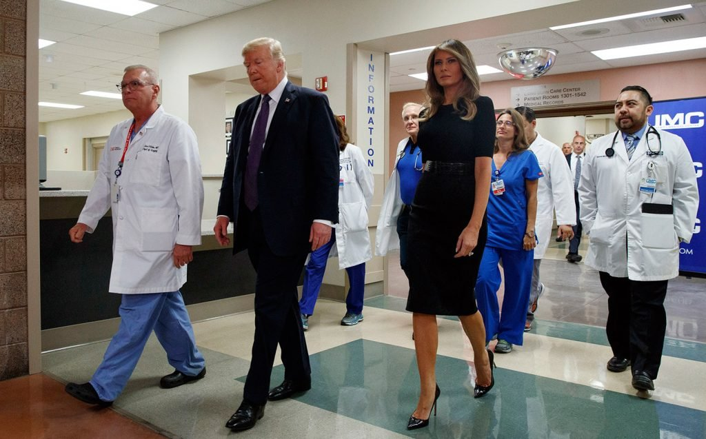 President Trump and first lady Melania Trump walk through University Medical Center in Las Vegas on Wednesday after meeting with people wounded in the mass shooting Sunday night.