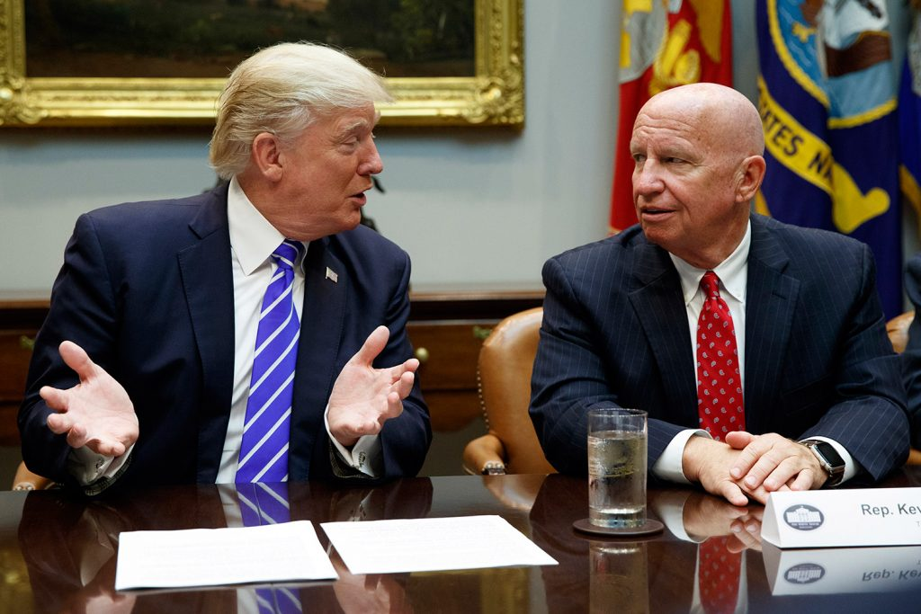 Rep. Kevin Brady, R-Texas, right, listens as President Trump speaks during a September meeting with members of the House Ways and Means committee in the Roosevelt Room of the White House.  Brady says he's discussing the 401(k) issue with Trump, who earlier this week shot down the possibility of changes to the popular savings program.