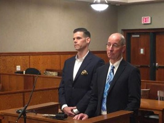 Alex Gray, left, pleads guilty to domestic violence assault in Cumberland County Superior Court on Friday. At right is his attorney, Gerard P. Conley Jr.