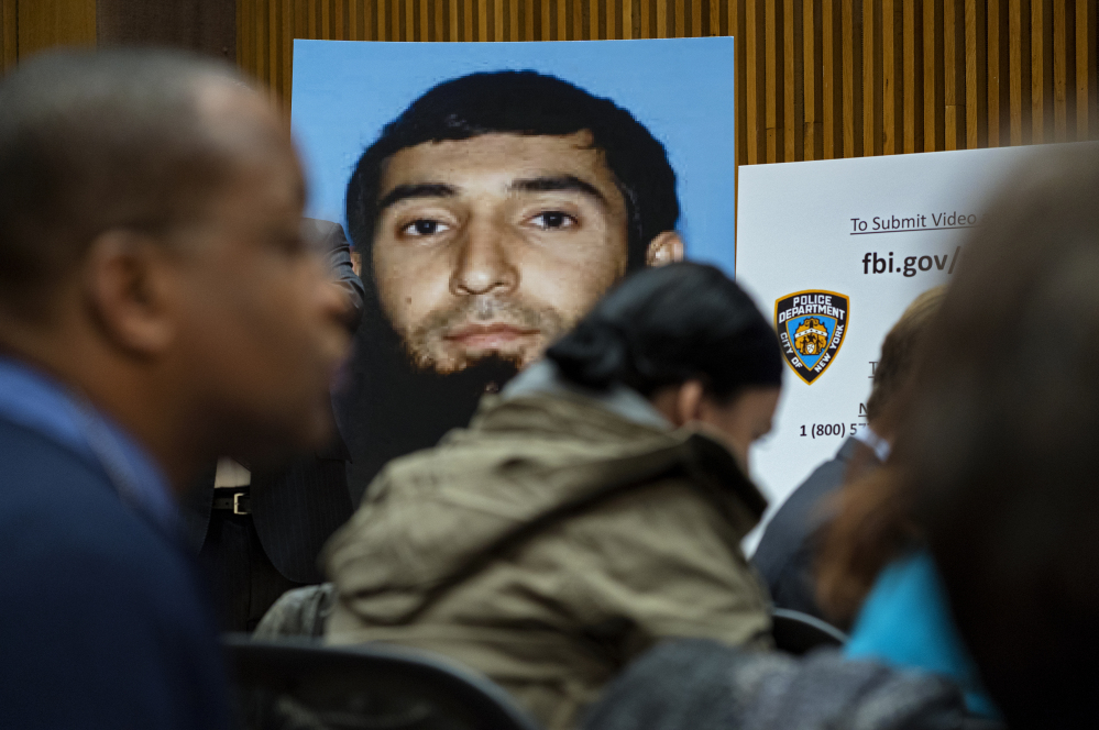 A photo of Sayfullo Saipov is displayed at a news conference at One Police Plaza on Wednesday in New York. Saipov is accused of driving a truck on a bike path that killed eight people and seriously injured others Tuesday near the World Trade Center memorial.