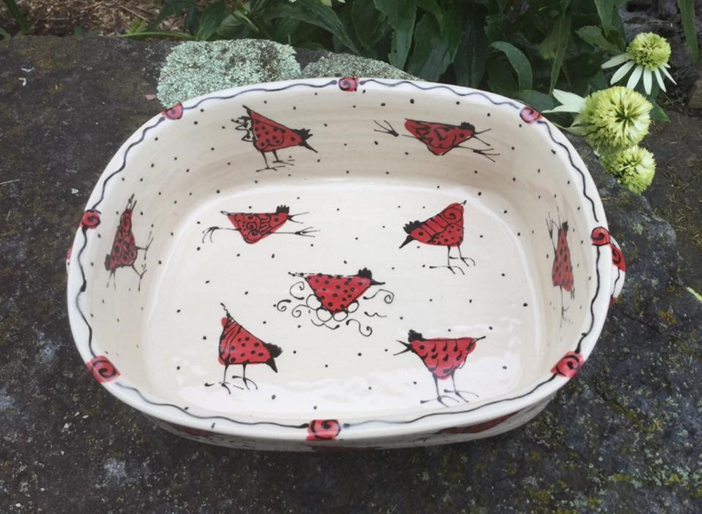 when robbi portela bakes a chicken casserole she serves it in a stoneware casserole dish decorated with quirky red chickens