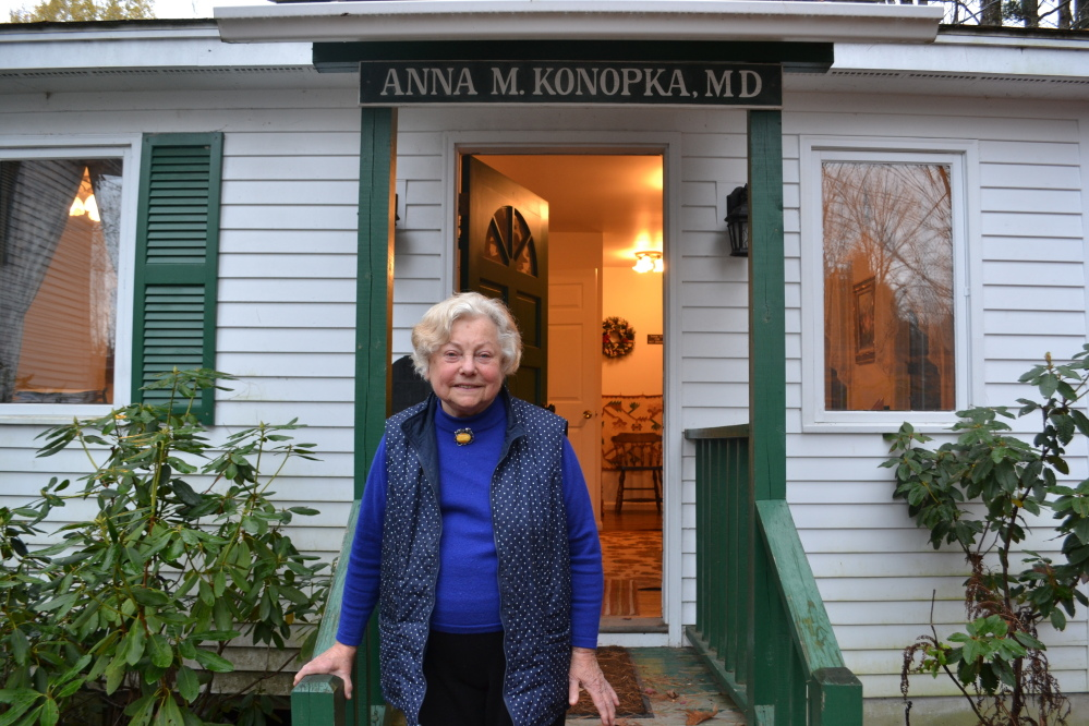 Dr. Anna Konopka stands in front of her tiny office in New London, N.H.