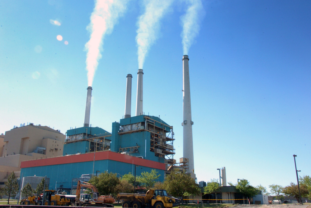 Smoke rises from the Colstrip Steam Electric Station, a coal burning power plant in Colstrip, Mont., in 2013. The government latest assessment of the climate concludes that,