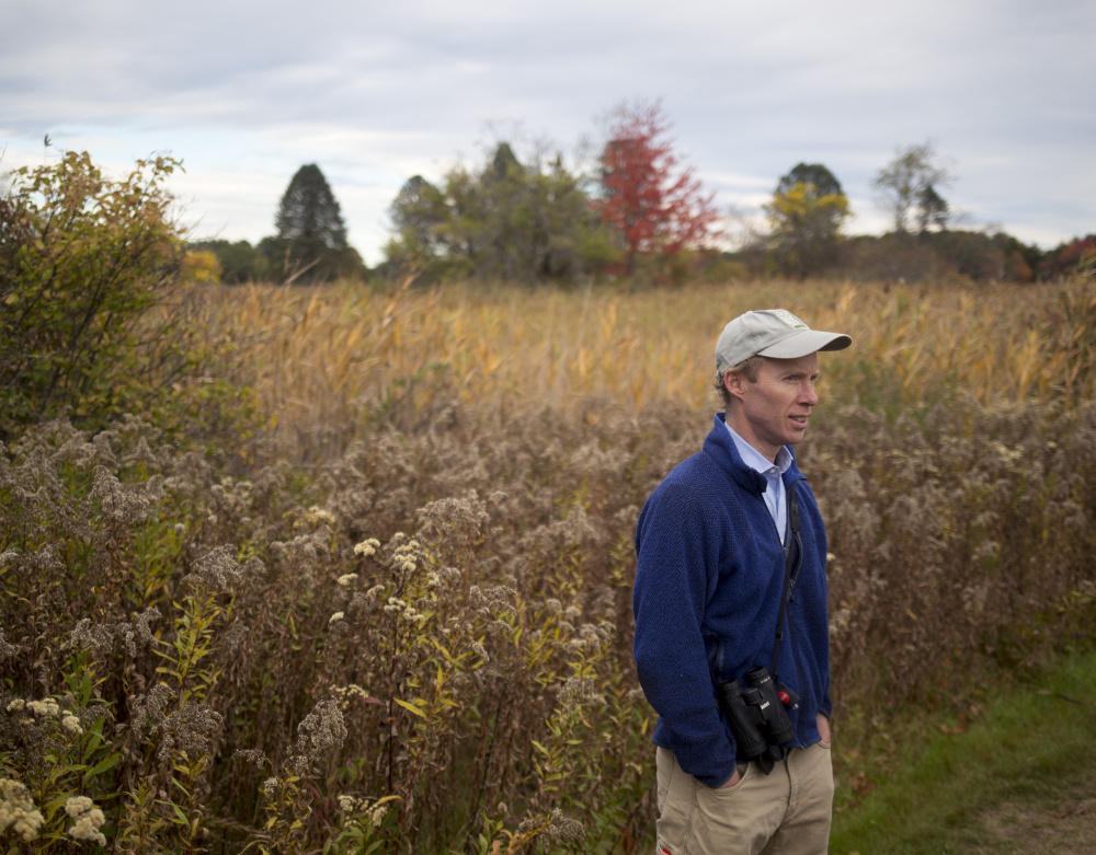 Angus King III, son and namesake of Maine's U.S. senator, walks the trails at Maine Audubon's Gilsland Farms in Falmouth. King said he has developed a love for hunting and birding, and feels his hunting experience makes him a more observant and aware bird watcher.