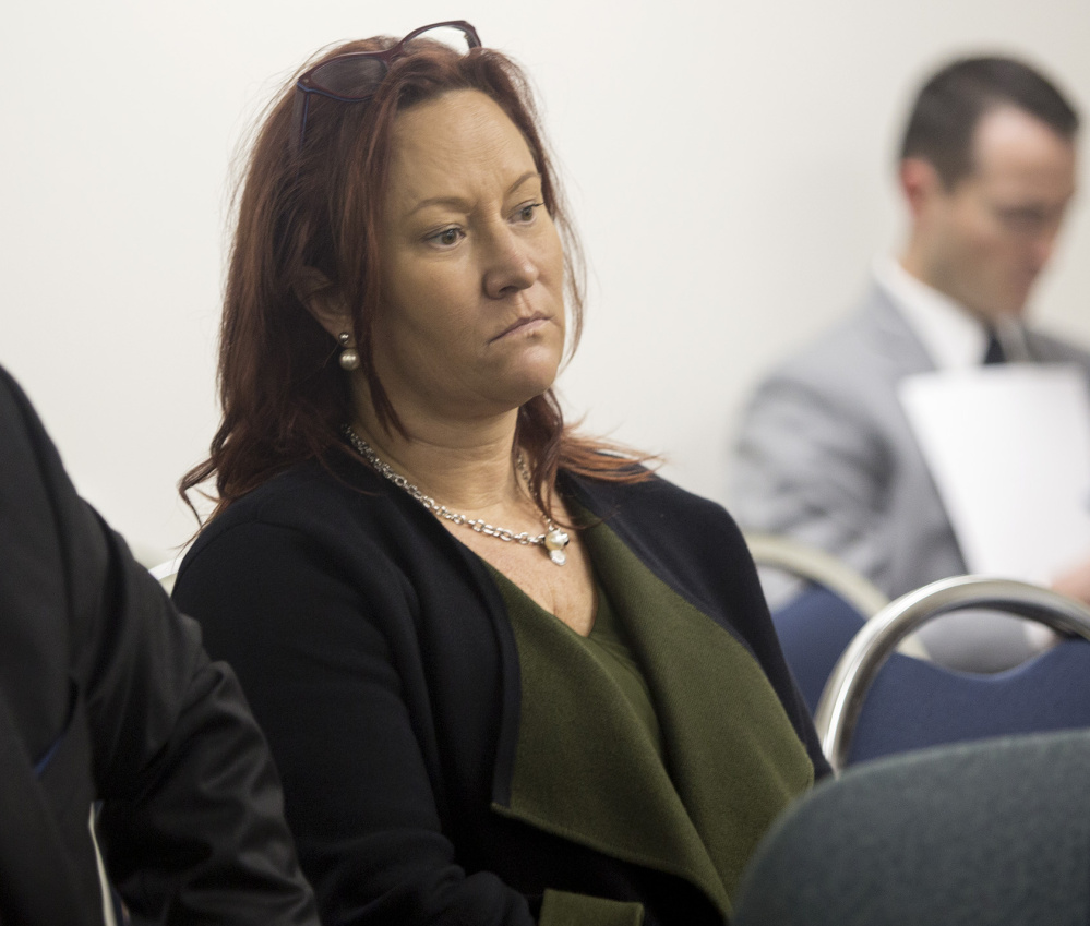 Lisa Scott listens Friday as the state ethics commission deliberates the campaign finance case against the committees behind the York County casino referendum. Scott formed three of the ballot question committees, which were fined Friday.