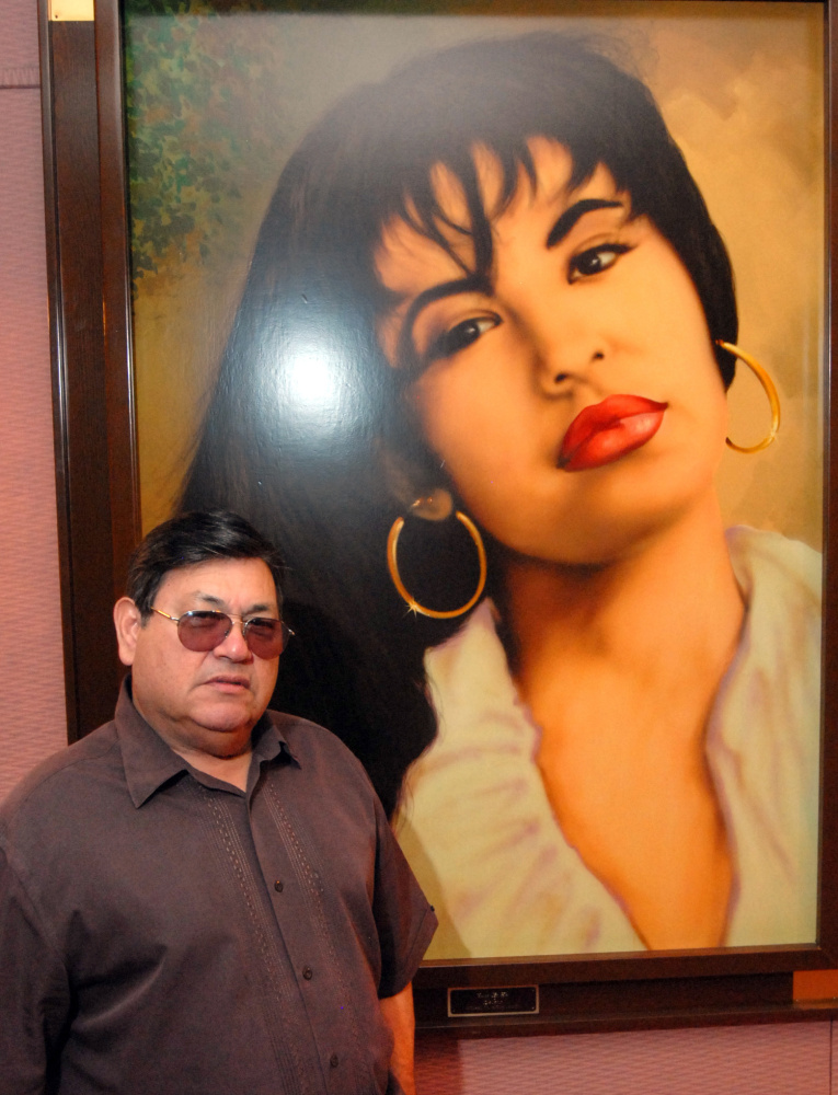 Abraham Quintanilla, father of the late Selena, poses in front of an airbrush work of the singer in 2011.
