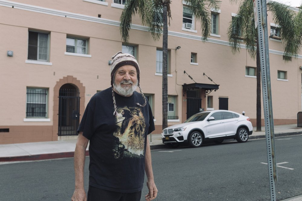Wendell Jones stands in front of the building in West Hollywood, Calif., where he has lived for 20 years, now paying just $700 a month for a studio – half of its market value - because of a rent stabilization ordinance that was used as a model for one proposed in Portland.