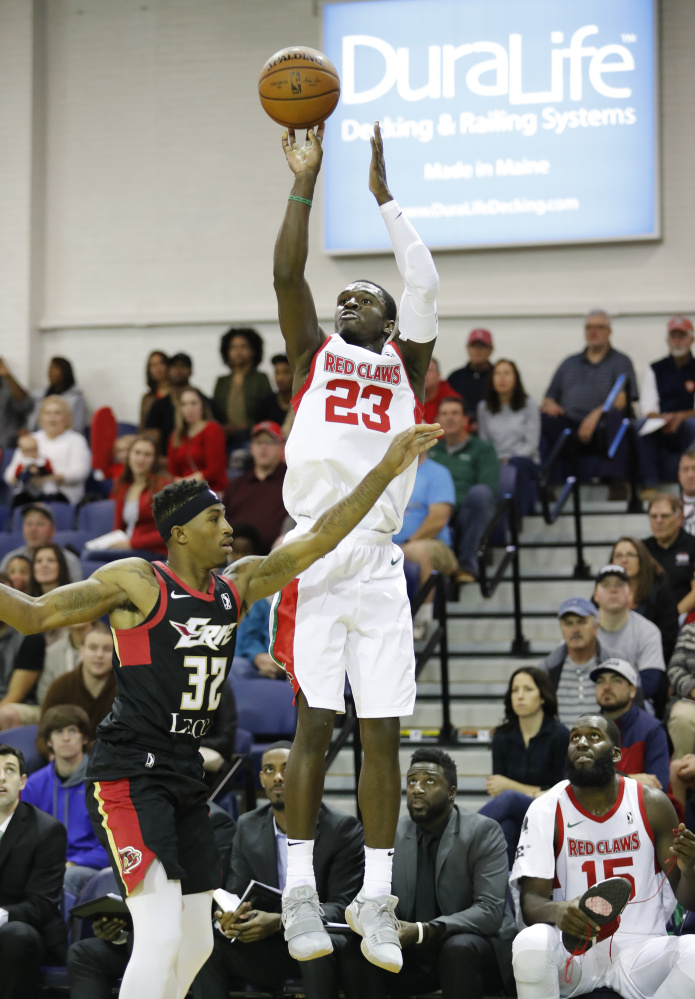 Maine's Jabari Bird shoots over Erie's Craig Sword during the first half of their game Sunday at the Portland Expo. Bird finished with 25 points and 10 rebounds in the Red Claws' 102-96 win.