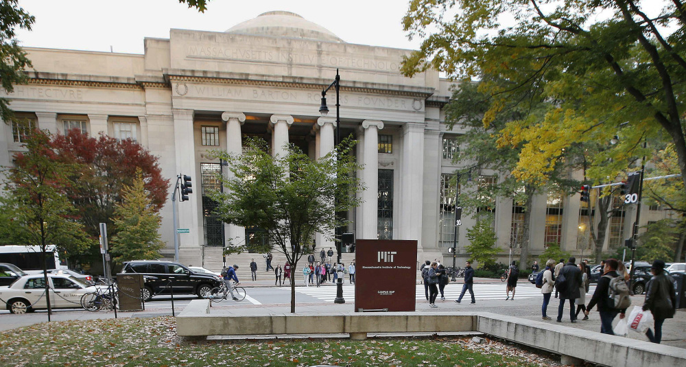 Students walk on the campus of the Massachusetts Institute of Technology in Cambridge. The state's Supreme Judicial Court will hear arguments Tuesday in a lawsuit filed against the university by the family of graduate student Han Nguyen, who killed himself in 2009.