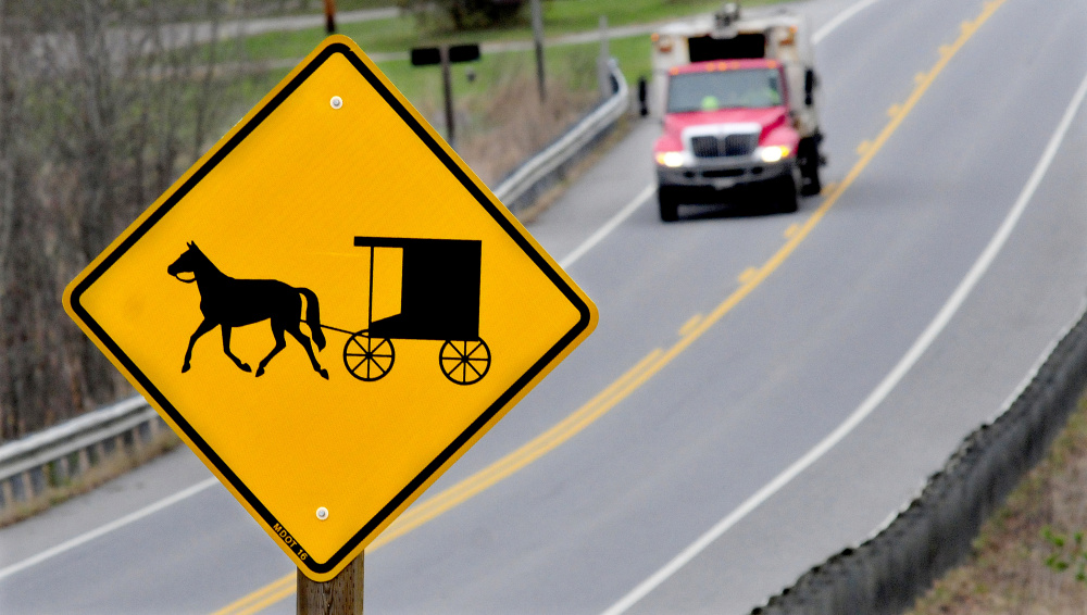 People driving into Unity see signs warning of horse-drawn wagons and buggies near a growing population of Amish.