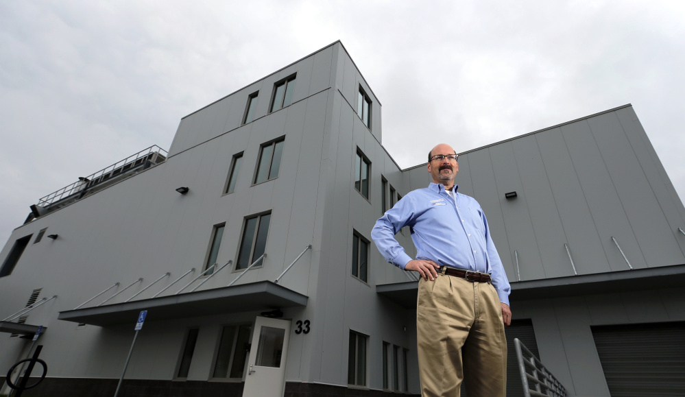 Michael Brigham, president and CEO of ImmuCell, stands outside the company's new building in the Riverside area of Portland. When fully complete, the facility will produce nisin – a natural antibiotic for dairy cattle.