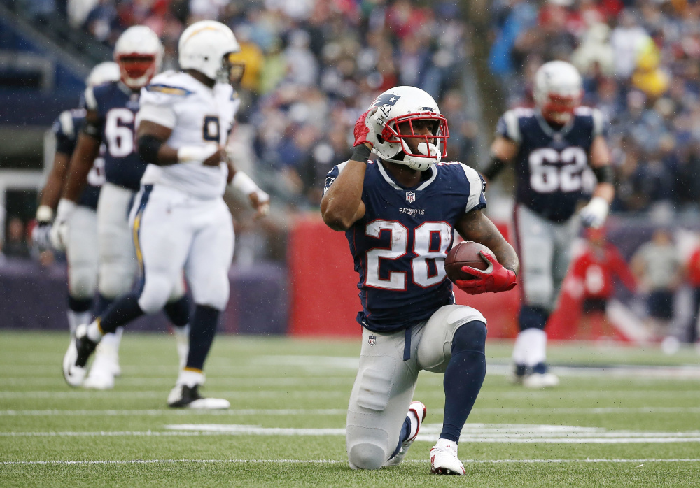 Running back James White, signaling a first down during the second half of New England's win over San Diego on Oct. 29, has been one of the Patriots' standouts in the first half of the season, despite somewhat limited opportunities.