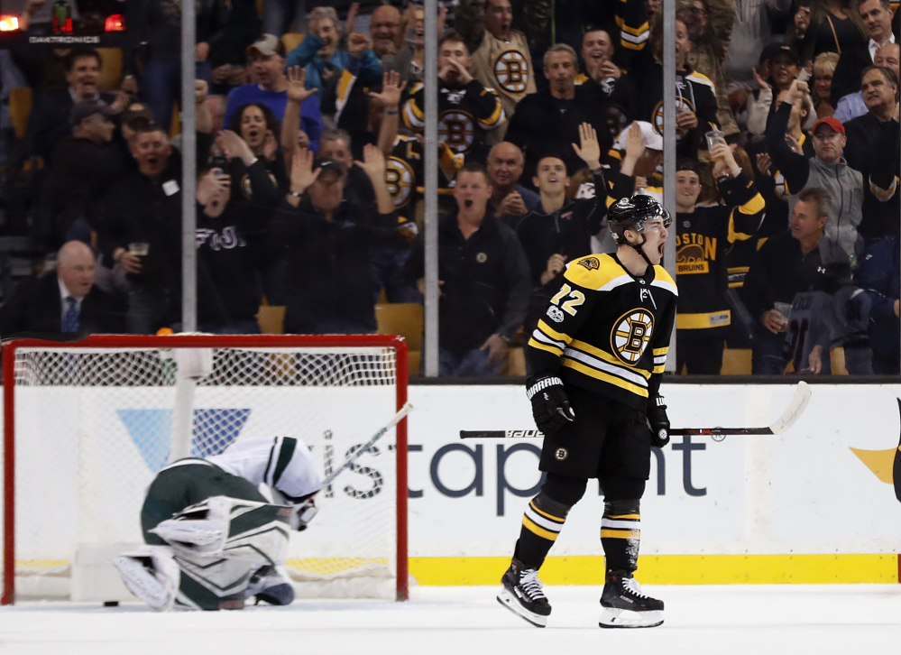 The Bruins' Frank Vatrano celebrates his goal on Minnesota Wild goalie Devan Dubnyk in the first period of Monday night's game in Boston. The goal gave Boston the lead for good.