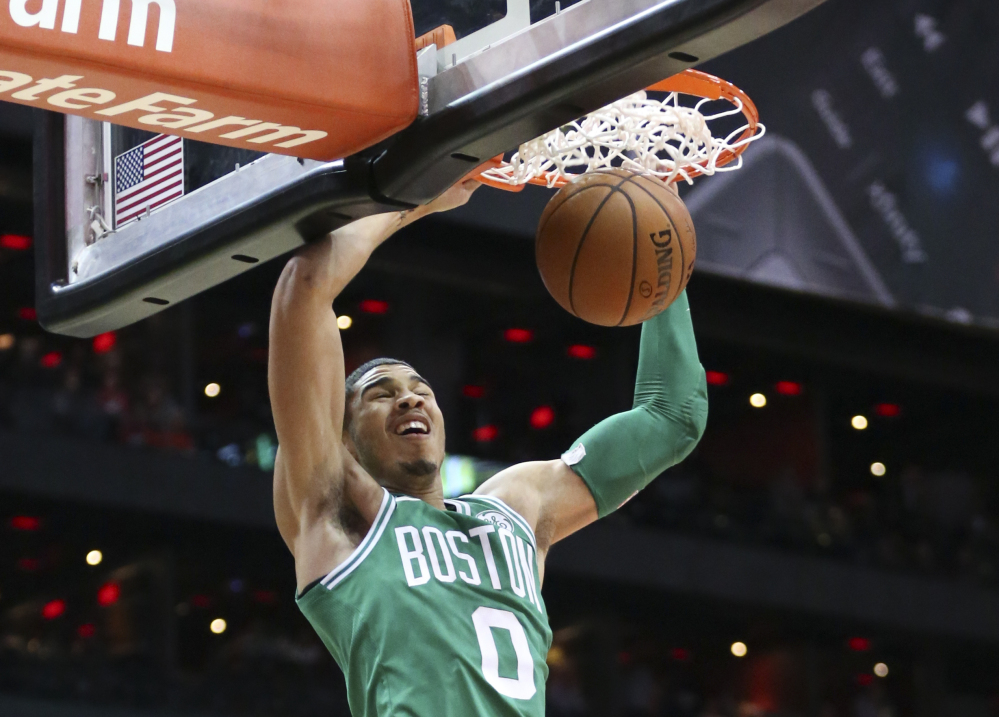 Celtics forward Jayson Tatum scores in the first half of Monday night's game in Atlanta, Boston's ninth straight win. Tatum finished with 21 points.