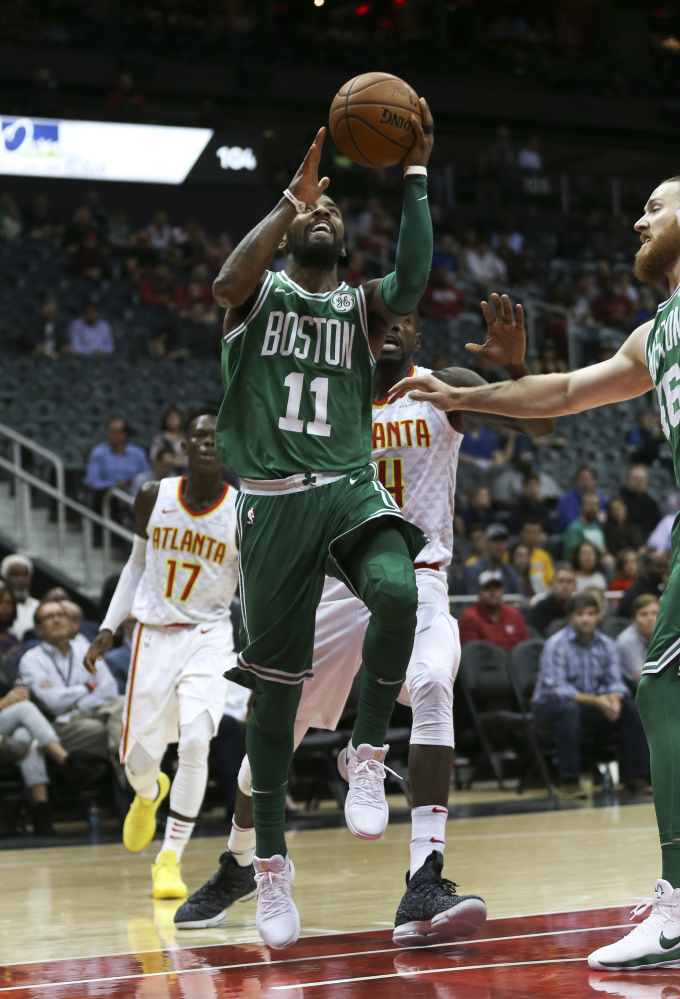Celtics guard Kyrie Irving (11) goes up for a shot in the first half. Irving was Boston's leading scorer in the win, with 35 points.
