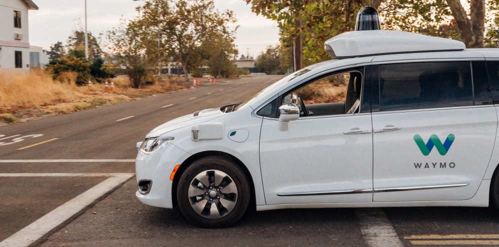 A Waymo self-driving van is tested in California. The car can detect bicyclists, pedestrians and vehicles, and stops when it detects a car coming the opposite way in its lane.