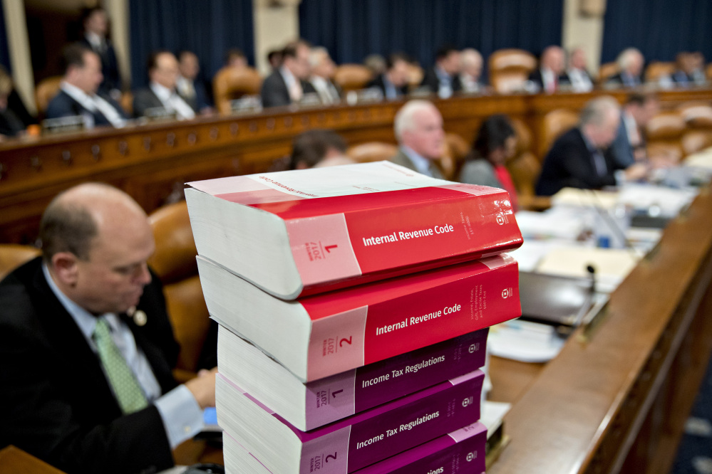 Tax code books sit on a table Monday as a House panel begins markup of the Republican tax bill.