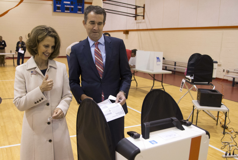Gubernatorial candidate Lt. Gov. Ralph Northam and his wife, Pam, vote in Norfolk, Va., on Tuesday. Northam, a Democrat, defeated Republican Ed Gillespie.