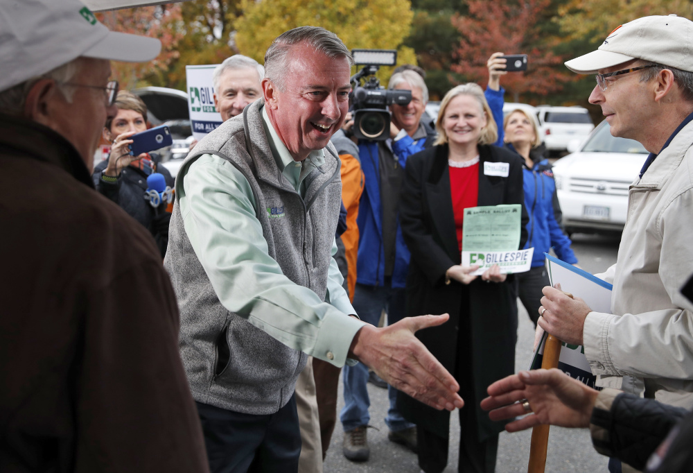Republican candidate for Virginia governor Ed Gillespie shakes hands with supporters before voting at his polling place Tuesday in Alexandria, Va. Gillespie lost to Democrat Lt. Gov. Ralph Northam in Tuesday's election. (AP Photo/Alex Brandon)