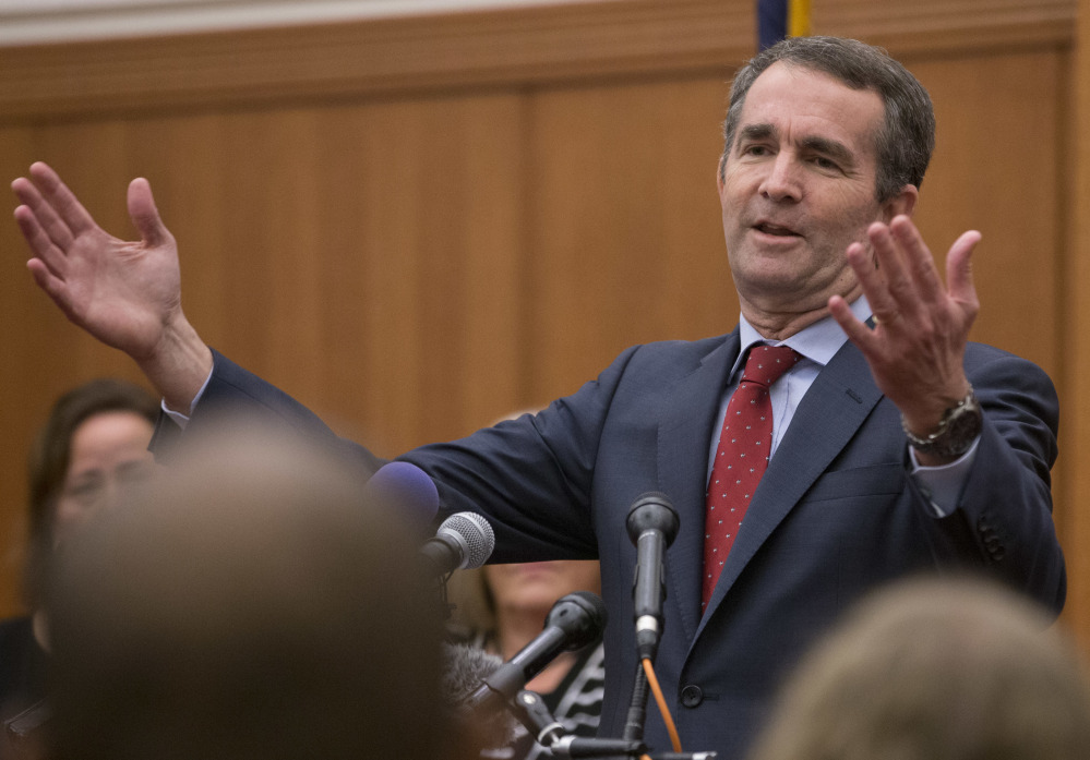 Virginia Gov.-elect Ralph Northam speaks to the media at the Capitol in Richmond, Va., Democrats see his win Tuesday as the beginning of an anti-Trump surge likely to crest in 2018.