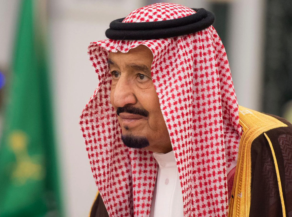 King Salman attends a swearing in ceremony in Riyadh on Monday. The king has sworn in new officials to take over from a powerful prince and former minister believed to be detained in the corruption sweep.
