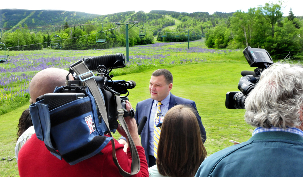 Sebastian Monsour of the Majella group is interviewed at Saddleback Mountain on June 28 after the announcement that his company would buy the ski area from Bill and Irene Berry. The sale still has not been completed, and a post Thursday on Saddleback's Facebook page offered little clarity about when it might be.