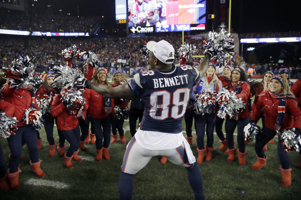 Tight end Martellus Bennett celebrates with cheerleaders after the Patriots won the AFC championship on Jan. 22, 2017, in Foxborough, Mass. The Patriots defeated the the Steelers 36-17 to advance to the Super Bowl. Bennett left for Green Bay in the offseason, but came back to the Patriots on Thursday.