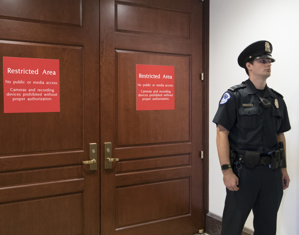 A U.S. Capitol Police officer stands guard outside a secure area in the basement of the Capitol, where the House Intelligence Committee has been conducting interviews. The panel is preparing to interview Russian-American lobbyist Rinat Akhmetshin.