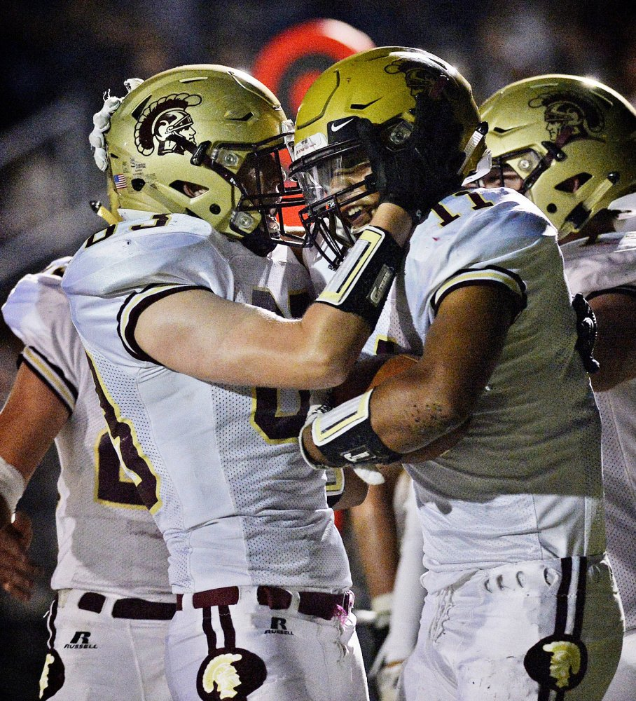CJ LaBreck, right, is congratulated by a teammate after one of his two touchdown receptions during Thornton Academy's 32-28 win over Scarborough on Sept. 15. The teams clash again Friday night in Scarborough, with a trip to the Class A state championship game on the line.