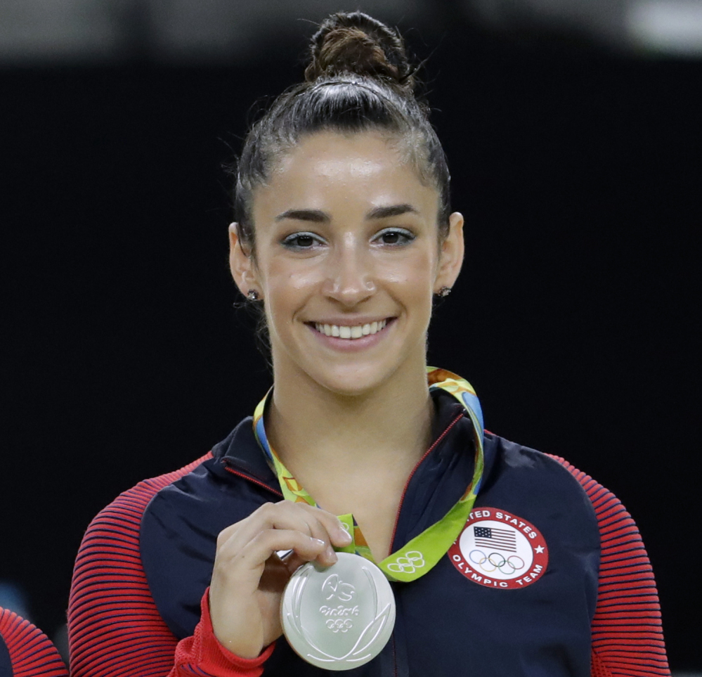 Aly Raisman shows off her silver medal after the artistic gymnastics women's apparatus final at the 2016 Summer Olympics in Rio de Janeiro, Brazil.