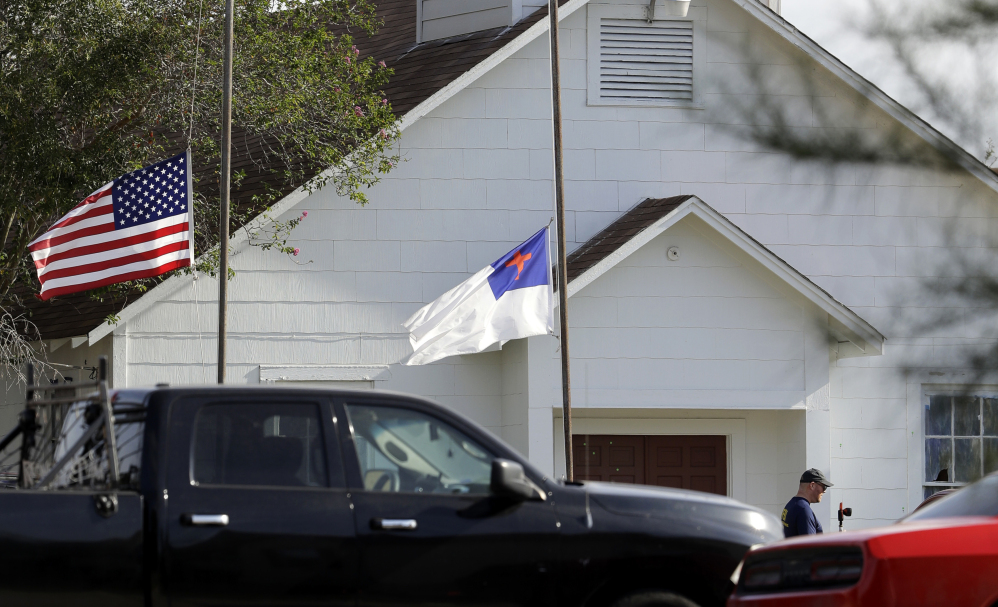 Flags fly at half-staff on Nov. 7 after a shooting at the First Baptist Church of Sutherland Springs in Sutherland Springs, Texas. A story claiming a man who killed more than two dozen people at the church on Sunday was a member of an anti-fascist movement intent on causing a civil war was false, the Associated Press reports.
