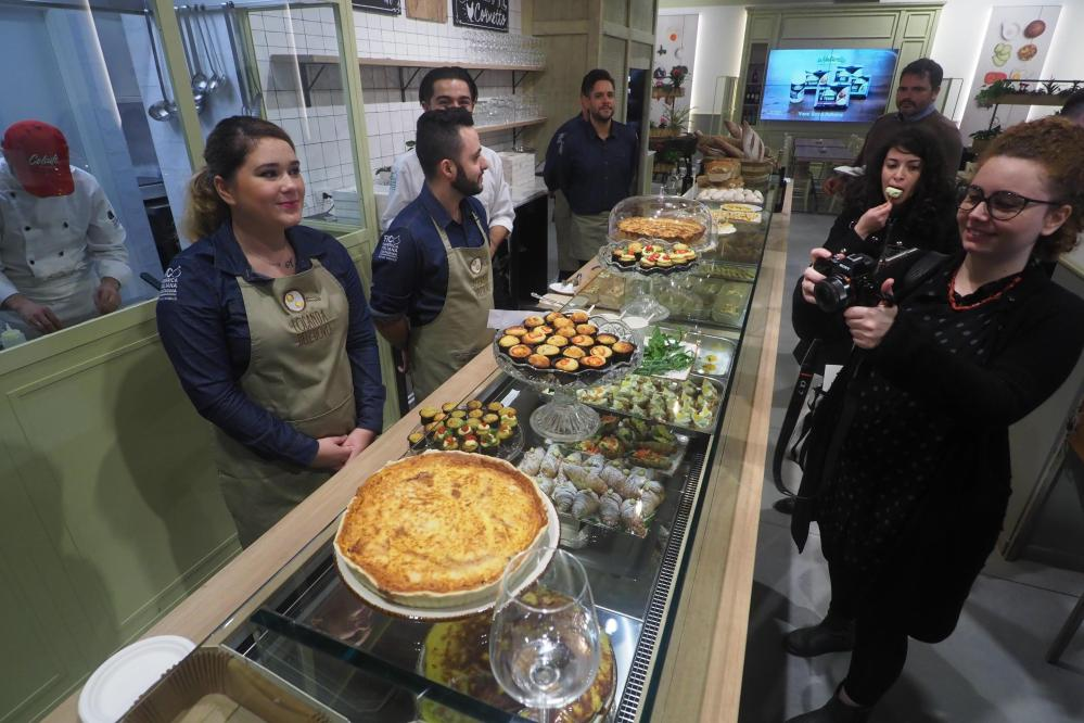 Visitors taste cakes at the