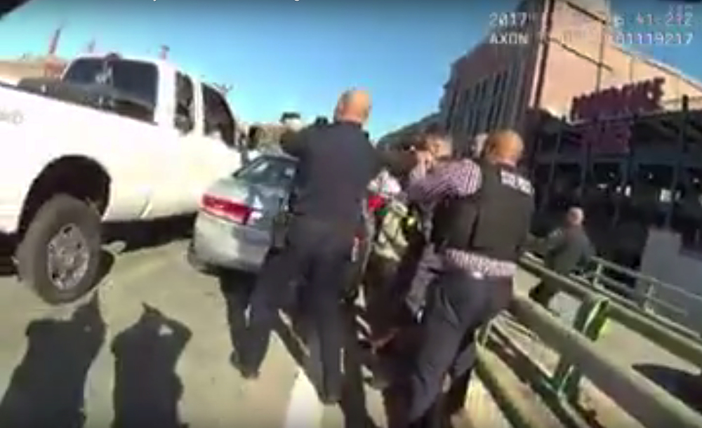A still image from a Providence Police officer's body camera shows officers converging on the truck Friday. They fired over 40 rounds, killing the driver and injuring a woman passenger.