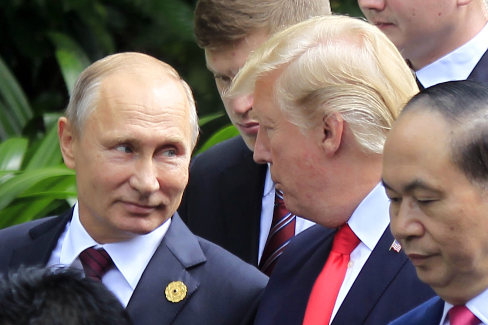Russian President Vladimir Putin and U.S. President Trump arrive for a photo session during the Asia-Pacific Economic Cooperation summit in Danang, Vietnam, on Saturday.
