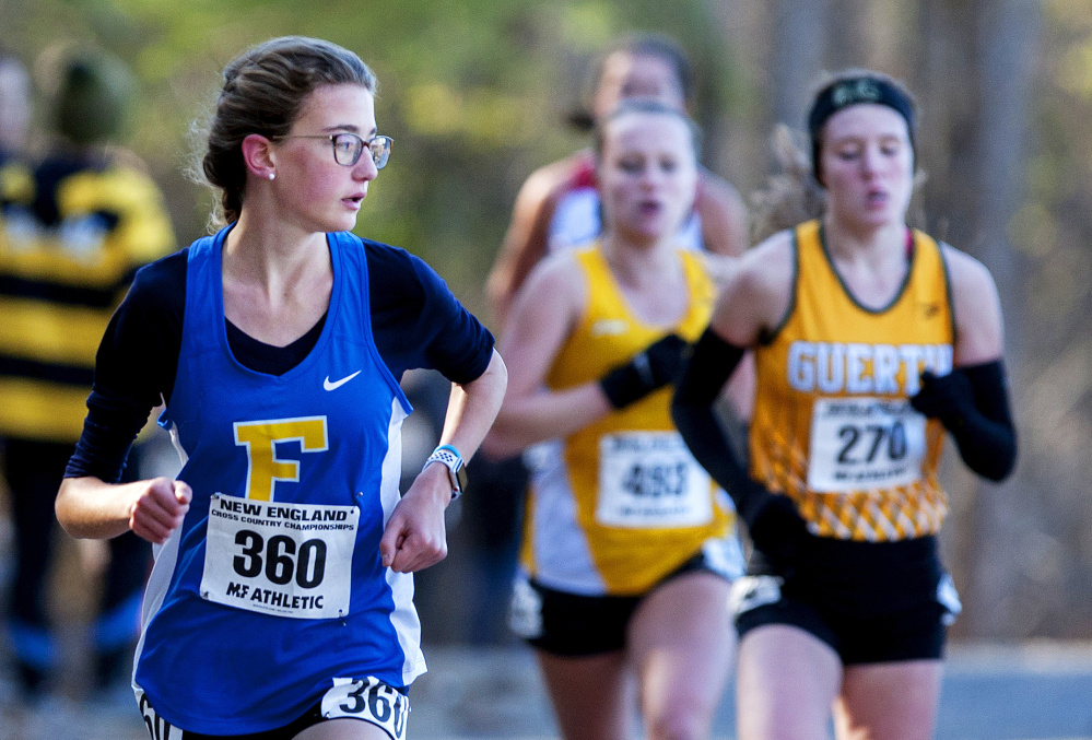 Sofie Matson of Falmouth looks over her shoulder during the New England high school cross country championships Saturday in Belfast. Matson was the first Maine girls' finisher, in 10th place.