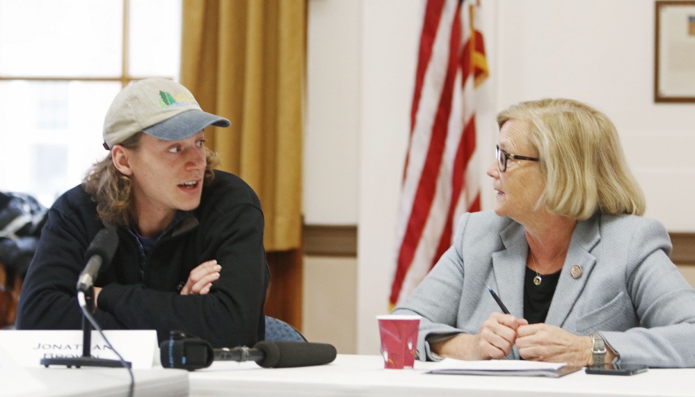 Jonathan Brown, a 2016 graduate of the University of New England, talks with U.S. Rep. Chellie Pingree during a round-table discussion at Portland City Hall regarding the Republican tax plan.