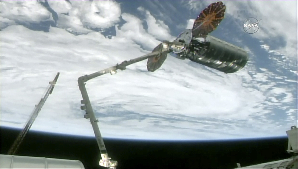 The International Space Station's robotic arm captures the Cygnus cargo spacecraft, Tuesday, Nov. 14, 2017, 260 miles  (418 kms.) above the earth. The commercial supply ship arrived at the International Space Station on Tuesday, two days after launching from Virginia.