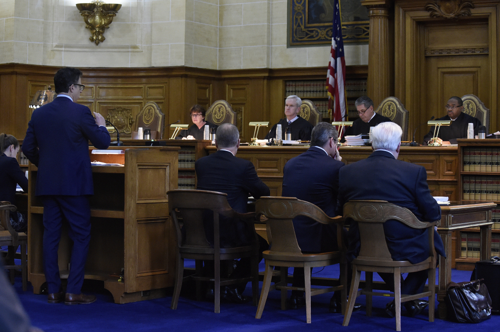 The Connecticut Supreme Court listens to attorney Josh Koskoff as he presents arguments on whether gun maker Remington Arms should be held liable for the 2012 Newtown school massacre, in Hartford, Conn., on Tuesday.