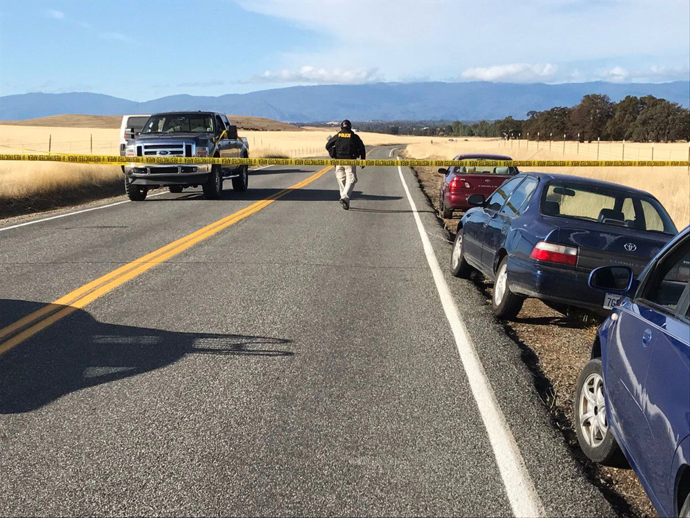 Crime tape blocks off Rancho Tehama Road leading into the Rancho Tehama subdivision south of Red Bluff, Calif., following  fatal shootings on Tuesday.