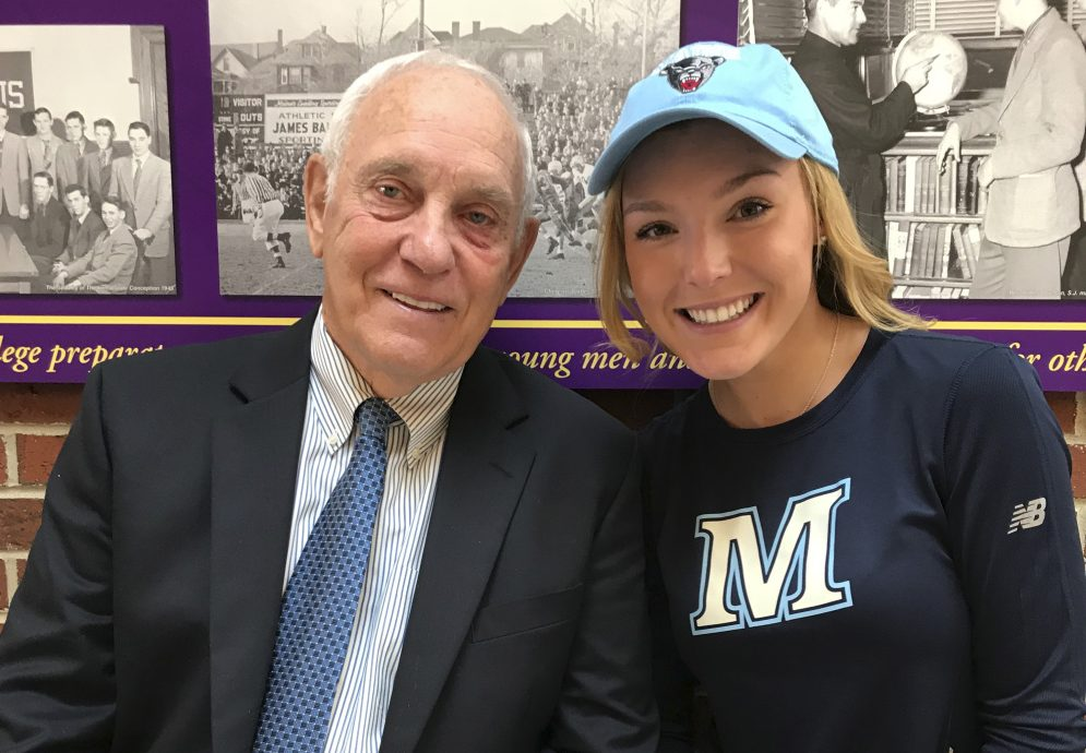 Hannah Abbott, a Cheverus senior, sits with her grandfather, former UMaine football coach Walt Abbott, after signing her letter of intent.