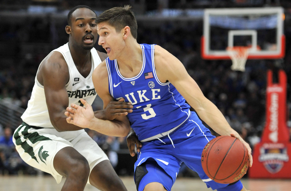 Grayson Allen of Duke, who scored 37 points, drives on Joshua Langford of Michigan State during the first half of Duke's 88-81 victory Tuesday night in an early-season game at Chicago between the nation's top-ranked teams.