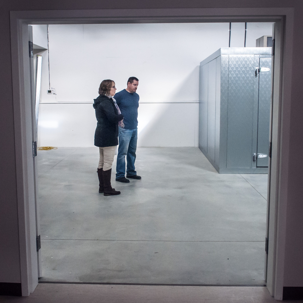 Pantry manager Susan Williams and warehouse manager Andy Waller talk about the facility's set-up Tuesday as they plan how to organize the new site of Augusta Food Bank on Mount Vernon Avenue in Augusta.