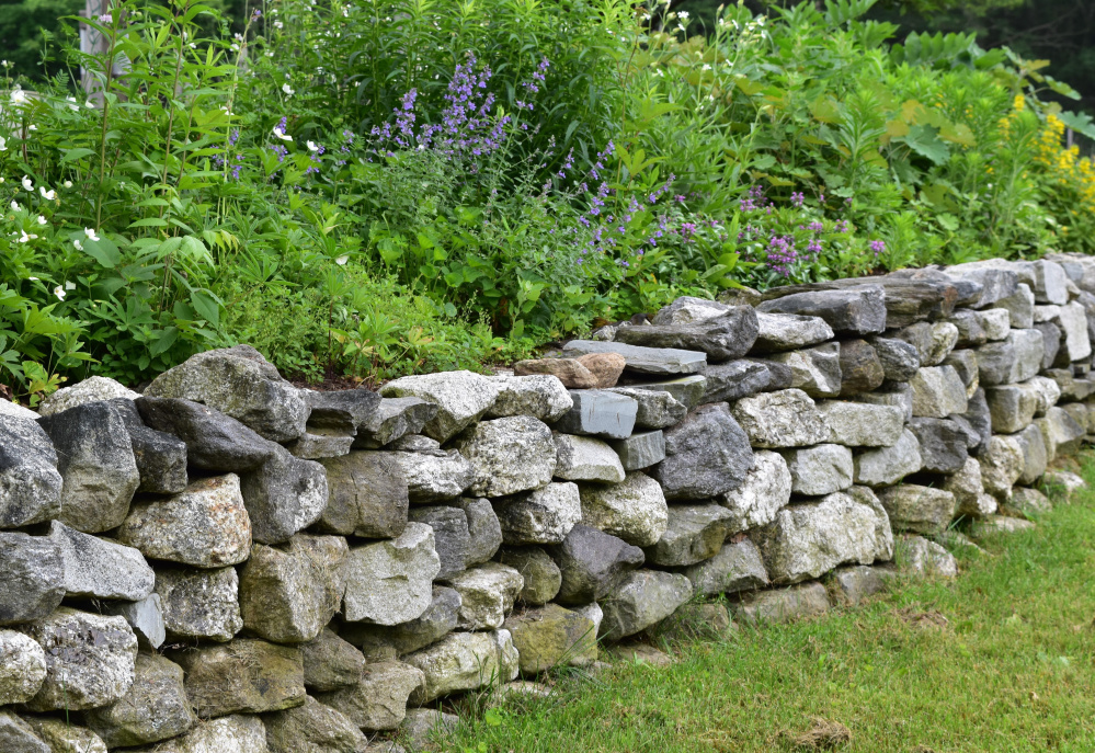 Features like stone walls should inform your garden design.