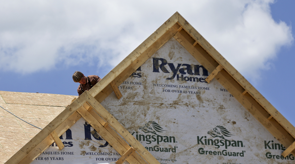 A builder works on the roof of a home under construction at a housing development in Jackson Township, Butler County, Pa. Apartment complexes drove new construction in the Northeast.
