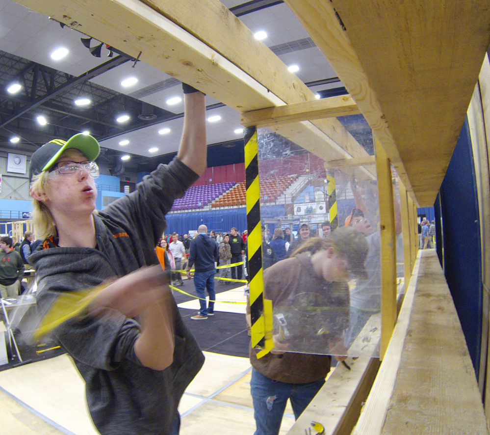 Noah Forget, of Oxford Hills, pounds nails Friday during a contest at the 18th Annual Crafts Championships at the Augusta Civic Center.